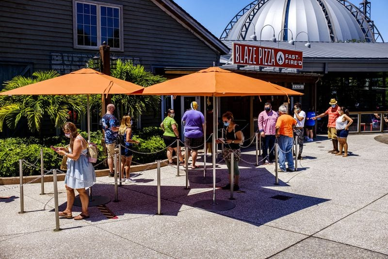 Guests lining up at Disney Springs reopening day [Source: Orlando Sentinel]