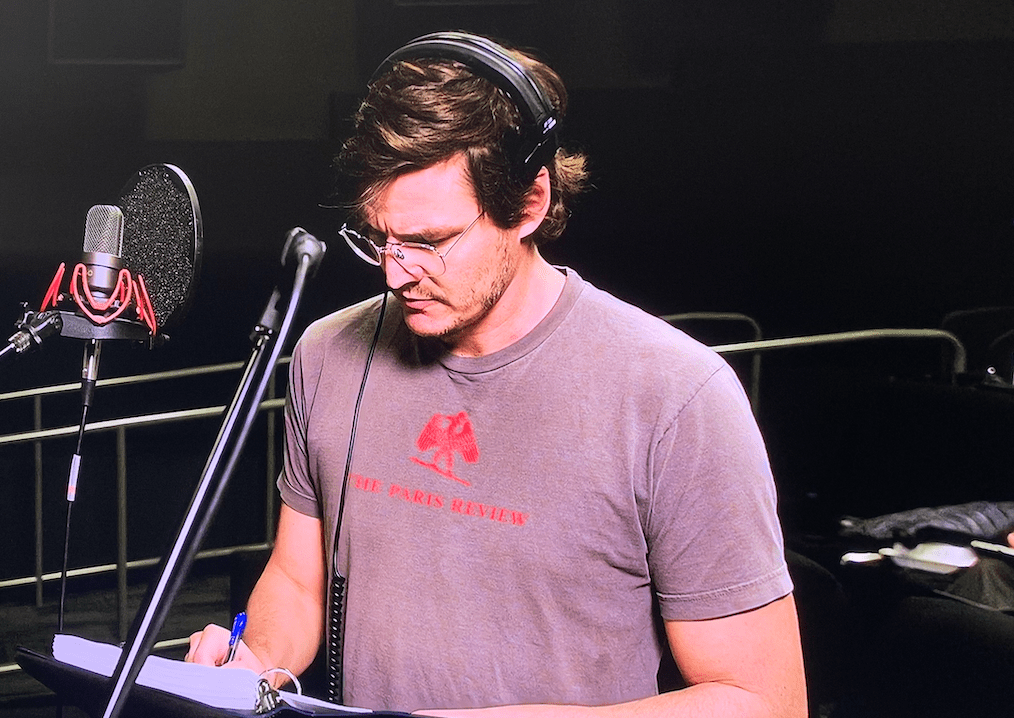 Pedro Pascal in a The Paris Review T-Shirt Reading VO for Disney Galery: The Mandalorian, Episode 3 [Source: Disney Plus]