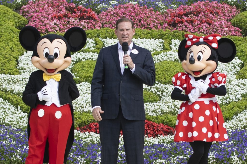 Joe Schott, President and General Manager of Shanghai Disney Resort, with Mickey and Minnie [Source: Disney Parks Blog]