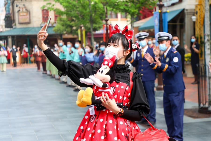 Girl in Minnie Mouse Costume Taking a Selfie [Source: Disney Parks Blog]