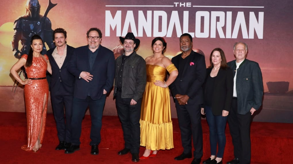 Dave Filoni (4th from Left) with Mandalorian Cast and Crew Members [Source: Mark Von Holden/Invision/AP via CTV News)