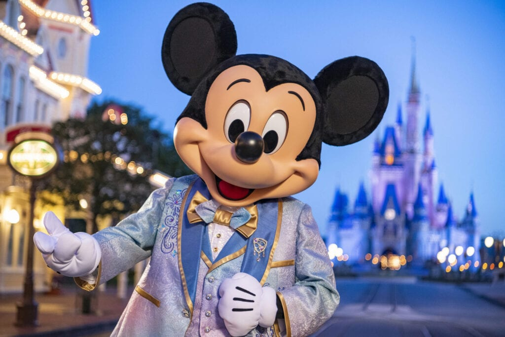 """Beginning Oct. 1, 2021, Mickey Mouse will join Minnie Mouse as hosts of """"The World's Most Magical Celebration"""" honoring Walt Disney World Resort's 50th anniversary in Lake Buena Vista, Fla. They will dress in sparkling new looks custom made for the 18-month event, highlighted by embroidered impressions of Cinderella Castle on multi-toned, EARidescent fabric punctuated with pops of gold. (Matt Stroshane, photographer)"""