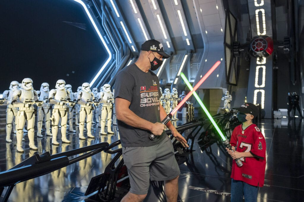 Gronk and His Nephew Dueling With Lightsabers [Source: Disney Parks Blog]