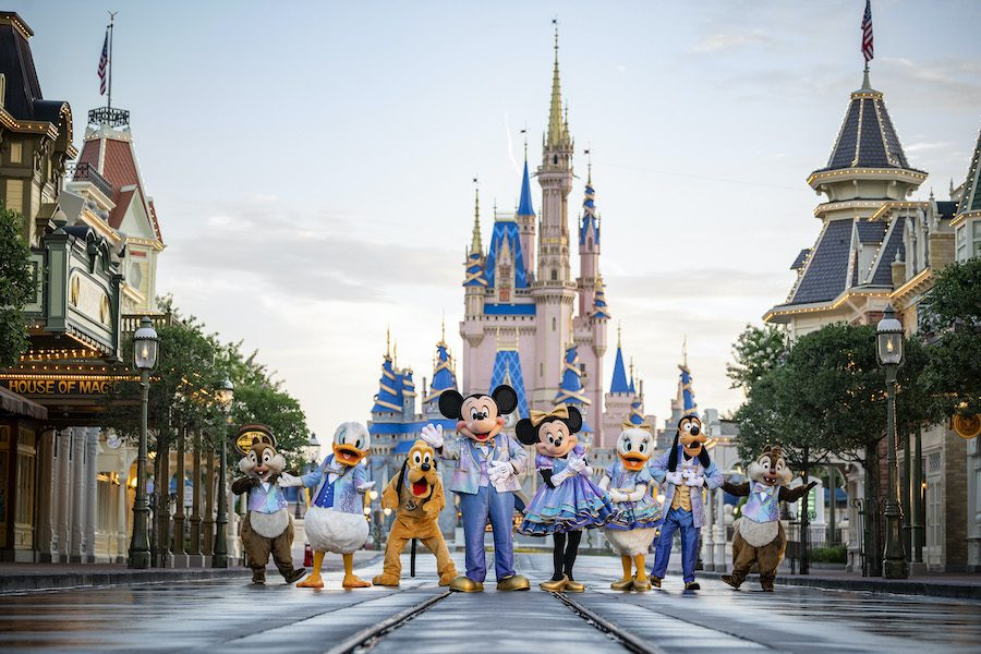"""""""Beginning Oct. 1, 2021, Mickey Mouse and Minnie Mouse will host """"The World's Most Magical Celebration"""" honoring the 50th anniversary of Walt Disney World Resort in Lake Buena Vista, Fla. Mickey and Minnie will be joined by their best pals Donald Duck, Daisy Duck, Goofy, Pluto and Chip 'n' Dale all dressed in sparkling new looks, custom-made for the 18-month event, highlighted by embroidered impressions of Cinderella Castle on multi-toned, EARidescent fabric punctuated with pops of gold."""" [Source: Disney (Matt Stroshane, photographer)]"""